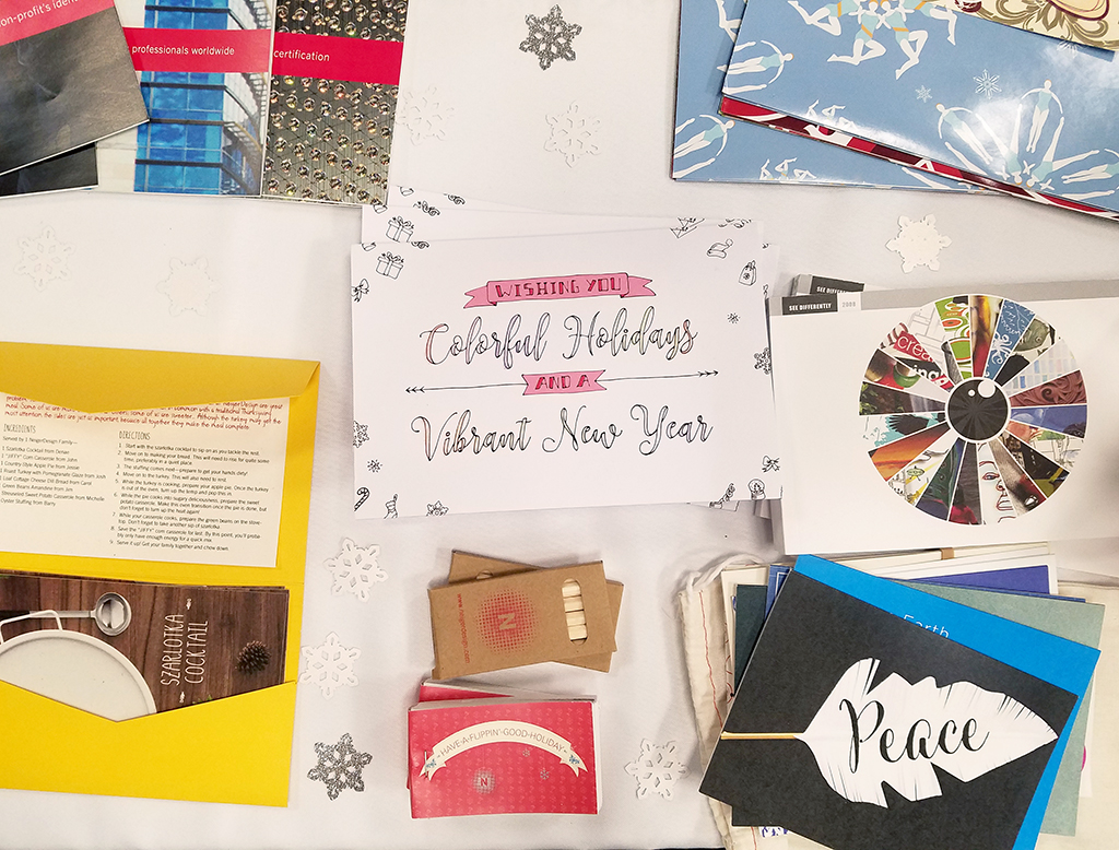NeigerDesign Holiday Showcase table with several holiday cards present